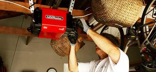 Technician working on Liftmaster garage door opener